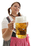 Bavarian Woman holding Oktoberfest beer in front Royalty Free Stock Image