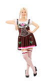 Bavarian woman leaning on an imaginary wall Stock Images