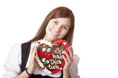 Bavarian woman in love holds Oktoberfest heart. Royalty Free Stock Photos