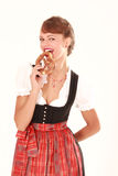 Bavarian woman with pretzel in his hand Royalty Free Stock Images
