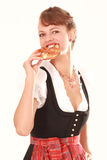 Bavarian woman with pretzel in his hand Royalty Free Stock Photos