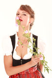 Bavarian woman smelling flower Royalty Free Stock Image