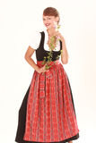 Bavarian woman smelling flower Royalty Free Stock Photo