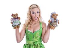 Bavarian woman with teddy bear Stock Photo