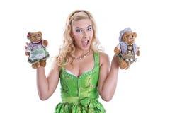 Bavarian woman with teddy bear Stock Photo