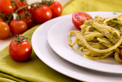 Bavette al pesto con pomodori. Pasta with basil and garlic sauce Royalty Free Stock Images