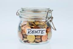 Bavure avec des pièces de monnaie pour la provision de pension Image libre de droits