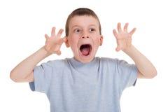 Bawić się chłopiec na bielu fotografia stock