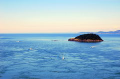 Bay. View of ocean, island and boats Royalty Free Stock Photography