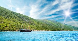 Bay in aegean sea and wooden yacht. Royalty Free Stock Image