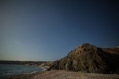 Bay of Aphrodite. Cyprus. Sea shore rock stones. blue sky day Stock Photo