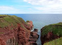 Bay in the Arbroaht Cliffs. A small bay between the cliff rocks at Arbroath on the North Sea in Scotland Royalty Free Stock Image