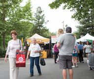 Bay Area Farmers Market. Danville, California, United States - June 05, 2016:  Townspeople walk at a farmers market, California, June 5, 2016 Stock Photos