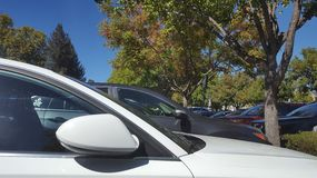 Bay Area Parking Lot. Danville, California, United States - October 01, 2016:  Close up of several cars parked in a parking lot on a sunny day in downtown Stock Photo