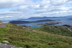 Bay around the Ring of Kerry Ireland. A rocky bay beyond stone walled fields, with islands, around the Ring of Kerry royalty free stock photography