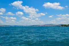 Bay with azure water under a blue sky with clouds. Azure waters of the Golden Horn Bay in Istanbul, stretching beyond the horizon. Under a blue sky with cumulus stock image