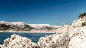 The bay of Baska in a sunny day. Baska and its beach in a sunny day royalty free stock photography