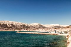 The bay of Baska in a sunny day. Baska and its beach in a sunny day royalty free stock images