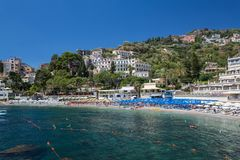 The bay and beach in Taormina in Sicily. Italy royalty free stock image