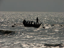 Bay of Bengal fishermen. Fishermen from Puri in the state of Orissa on the east coast of India going fishing in the Bay of Bengal Stock Image
