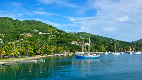 Bay at Bequia Harbor. Boats drift on their anchor lines at a Caribbean harbor Royalty Free Stock Photography