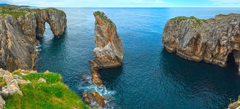 Bay of Biscay rocky coast, Spain. Bay of Biscay summer rocky coast view, Spain, Asturias, near Camango. Two shots stitch panorama Royalty Free Stock Image