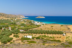 Bay with blue lagoon and olive trees. On Crete, Greece Stock Photos