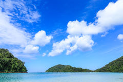 Bay with Blue Sea, Blue Sky and Cloud. Blue Sea With Blue Sky and Cloud at Marine National Park in Phangnga, Thailand Royalty Free Stock Image