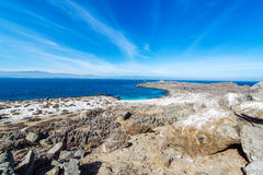 Bay and Blue Water on Damas Island Royalty Free Stock Photography