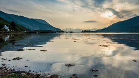 Bay with boats ast dusk in Scotland stock video footage