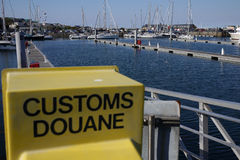 A bay with boats and customs sign Royalty Free Stock Photos