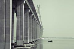 Bay bridge. Below the bridge is a serene scene Stock Photo