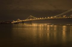 Bay Bridge. And Oakland port at Night Stock Images