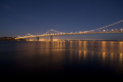 Bay Bridge. At night, long exposure resulting in silky water Royalty Free Stock Photography