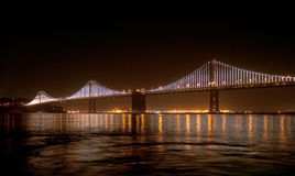 Bay Bridge with Bay Lights On. Bay Bridge connecting San Francisco and Oakland got a new artwork, an iconic light sculpture designed by world-renowned artist Leo Royalty Free Stock Photos