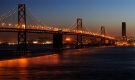 Bay Bridge in the dusk. A high-resolution stitched image of Bay Bridge (shot from Treasure Island). Copyspace on top and bottom right Stock Photos