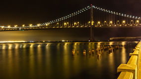 The Bay Bridge at Night. The San Francisco - Oakland Bay Bridge viewed at night from the Embarcadero Stock Photography