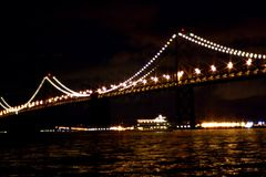 Bay Bridge at night. The Bay Bridge at night, shot using a star filter to make the lights twinkle royalty free stock photo