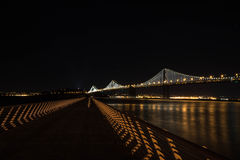 The Bay Bridge by night, San Francisco. A night view of the Bay Bridge  and the bay in San Francisco Stock Image