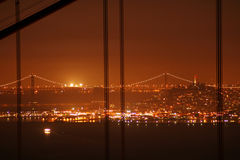 Bay Bridge seen from the Golden Gate Bridge at night Royalty Free Stock Photo