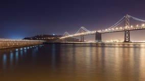 Bay Bridge towards Treasure Island. Night view of Bay Bridge and a pier in San Francisco Stock Images