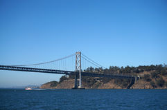 Bay Bridge, yerba buena island and boat sailing under. On a nice day in California Stock Photo