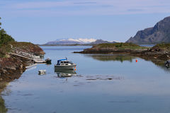 Bay in Bronnoysund Norway with mountains Seven Sisters in the background Stock Images