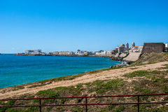 Bay of Cadiz. Coast Cadiz Bay with sea and blue sky. In the distance one sees the Cathedral of Cadiz Stock Images