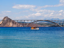 Bay on the coast of Croatia. The bridge to the island of Krk seen from the bay stock photography