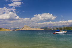 Bay on the coast of Croatia. The bridge to the island of Krk seen from the bay stock images