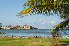 Bay of Cojimar Cuba. Bay of Cojimar with the ancient fort. The beach is cluttered with plastic clutter and junk. Cojimar, Cuba stock images