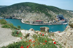 Bay in Crimea. Ukraine, Crimea, Balaclava bay, harbor for yachts and the small ships royalty free stock photo