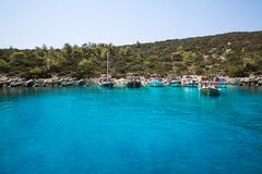 Bay with crystal blue water of Mideterranean sea Aegean Turkey, Bodrum. Blue crystal water of Mediterranean sea Aegean in bay near the Turkey, Bodrum. Tourists royalty free stock photography