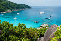 Bay with crystal water on Similan island, Thailand. Bay with crystal water and yachts on Similan island, Thailand Royalty Free Stock Photography